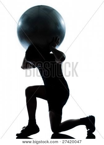 one n man workout holding fitness ball exercising workout aerobic fitness posture full length silouhette on studio isolated on white background