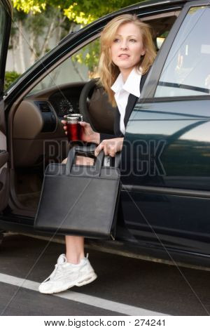 Business Woman Getting Out Of Car At Work