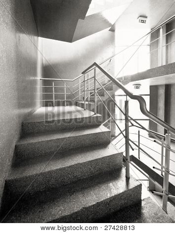 Empty concrete building stairway composition.