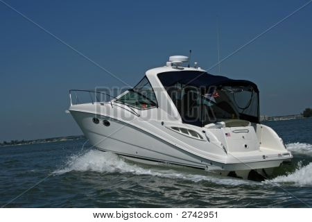 Speeding Power Boat At Sea With Clear Sky Background