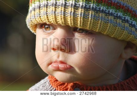 Adorable Toddler In A Wooly Cap