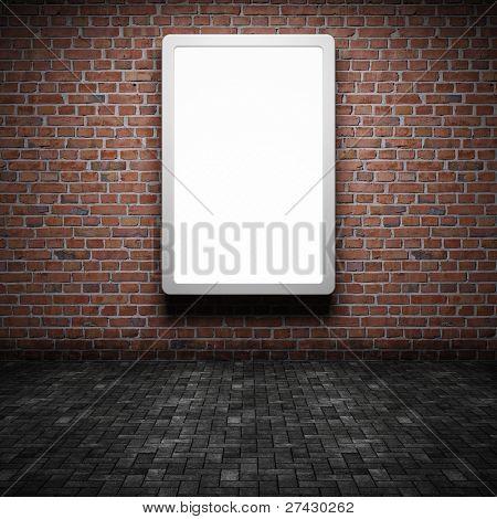 Cartelera de publicidad calle en blanco en la pared de ladrillo en la noche