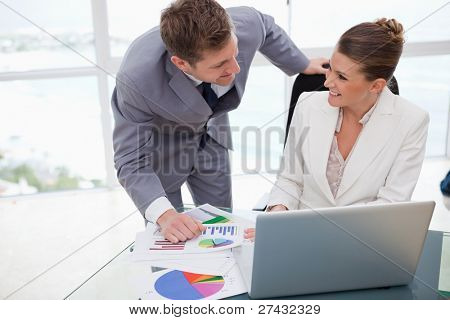 Business team analyzing poll results together