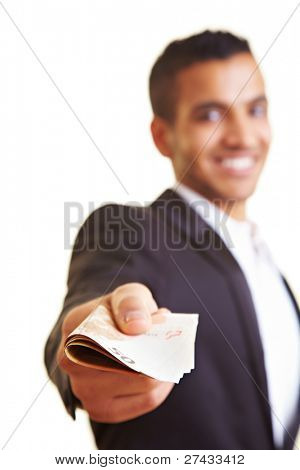 Young business man offering a stack of money