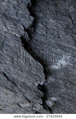 Dark grey slate stone with a break