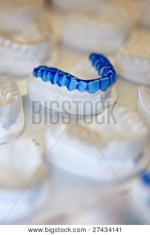 COLOGNE - MARCH 22: Many different occlusal splints to protect tooth surfaces on display at the IDS Dental Industry trade show in Cologne, Germany on March 22, 2011.
