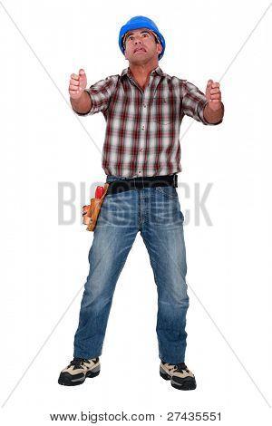 Laborer gripping an imaginary ladder