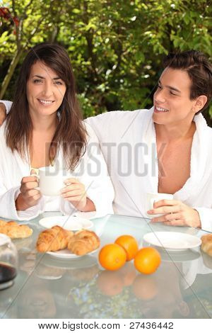 Couple having breakfast outside