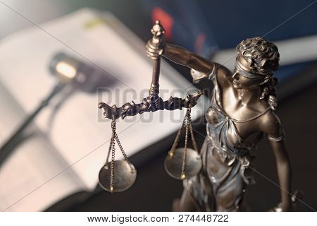 Statue Of Justice On Books