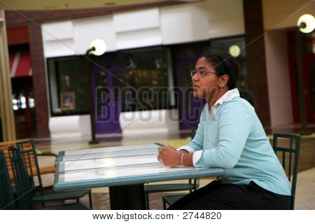 Woman Sits At Cafe