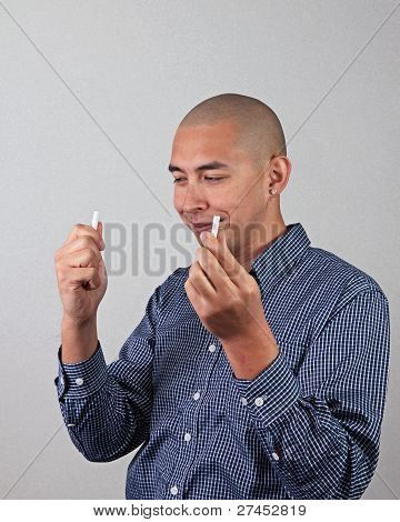 Man Breaks Cigarette