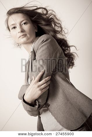 Young woman portrait with her hair flying