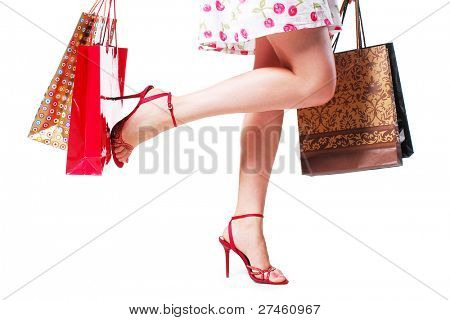 Beautiful legs in shoes isolated on white background
