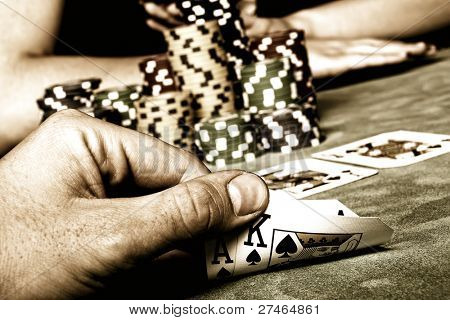Beautiful hands holding a deck of playing cards