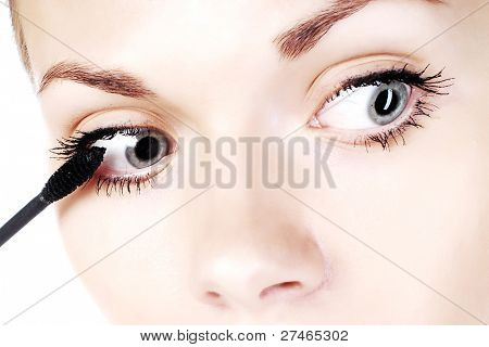 young woman with eyeliner for her eyelashes