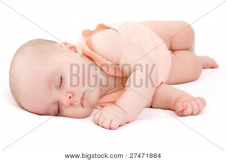 Baby Sleeps On A White Background.