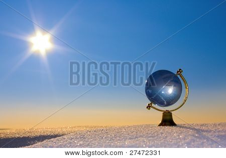 Glass Globe In The Snow.