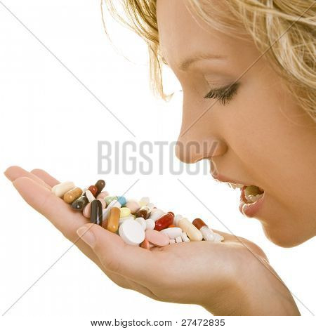 Blonde woman taking many pills