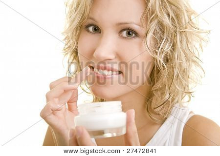 Blonde woman using lotion