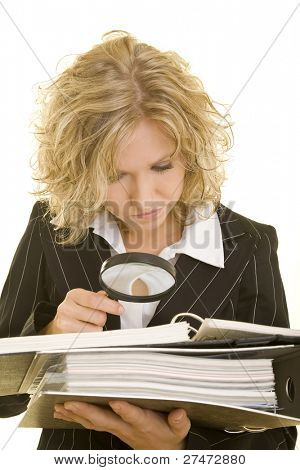 Blonde woman looking through a magnifying glass