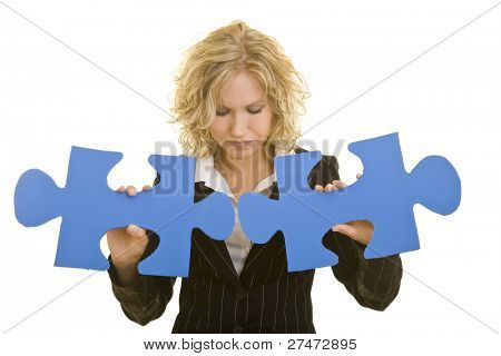 Blonde woman with big jigsaw pieces