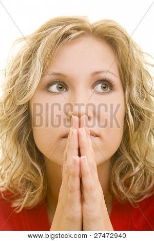 Young blonde woman praying
