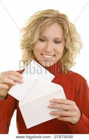 Blonde woman holding an envelope