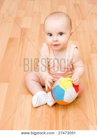 The Kid On The Floor Playing Ball