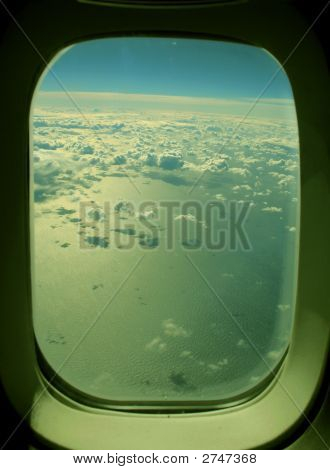 Airplane Window - Clouds Over The Ocean