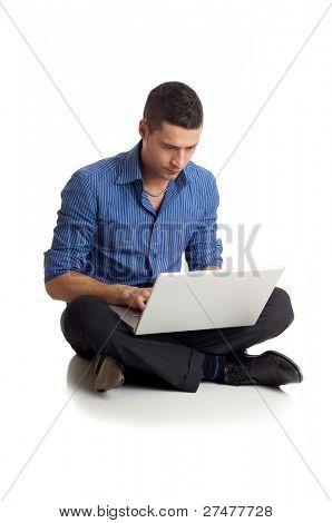 man typing at laptop