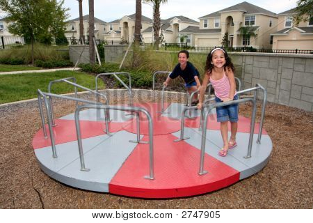 Young Girl And Boy On Playground