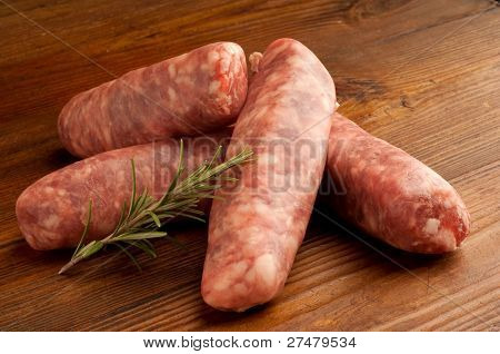 group of raw sausage and rosemary horizontal shoot