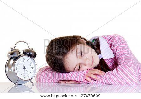 sleeping child and alarm clock