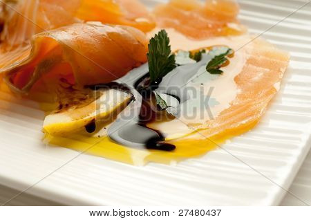 smoked salmon marinated on olive oil and balsamic vinegar close up