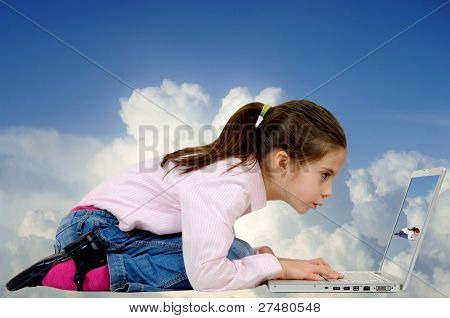 little girl with laptop on the clouds