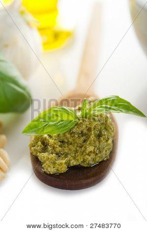 pesto sauce over spoon close up
