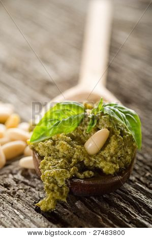pesto sauce over spoon close up