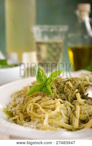 pesto pasta on dish close up