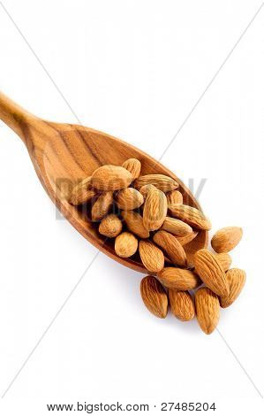 almonds over spoon isolated on white