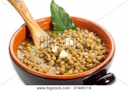 lentils soup with spoon over bowl