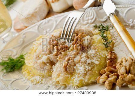 nuts ravioli with parmesan cheese