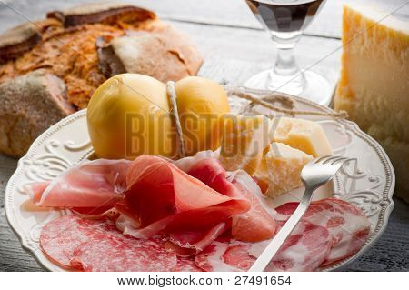variety of italian salami cheese and wine