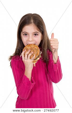 little girl eating hamburger with thumb up
