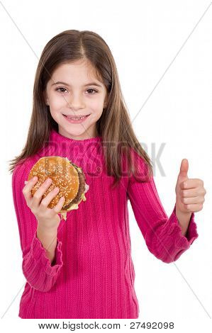 smiling little girl eating hamburger with thumb up
