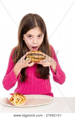 little girl eating hamburger on withe background