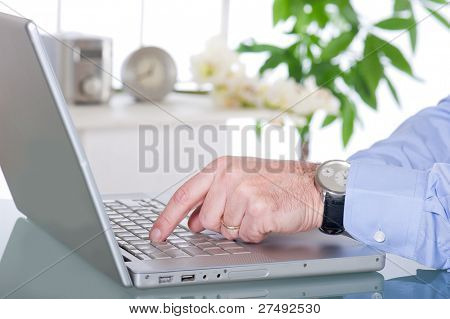man using notebook at home, office
