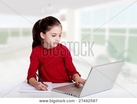little girl studying with computer