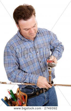 Plumber Repairs Pipe
