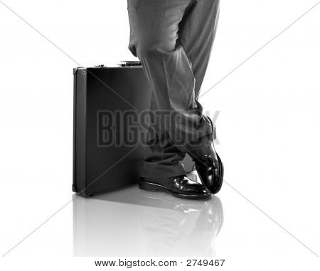 Standing With A Briefcase (With Clipping Path And Reflection)