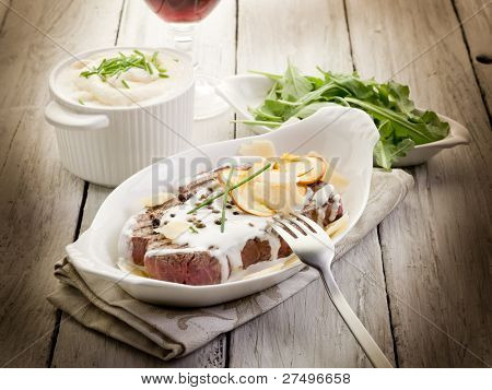 tenderloin with cream sauce ovum mushroom and arugula salad